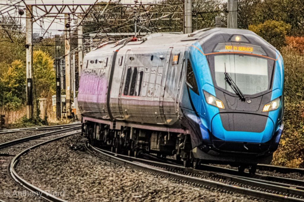 Shiny new TPE Class 397001 makes the approach to Lancaster